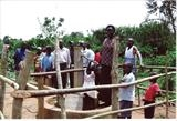 Villagers grouped around the well by Deborah Elizabeth McNeill, Photography